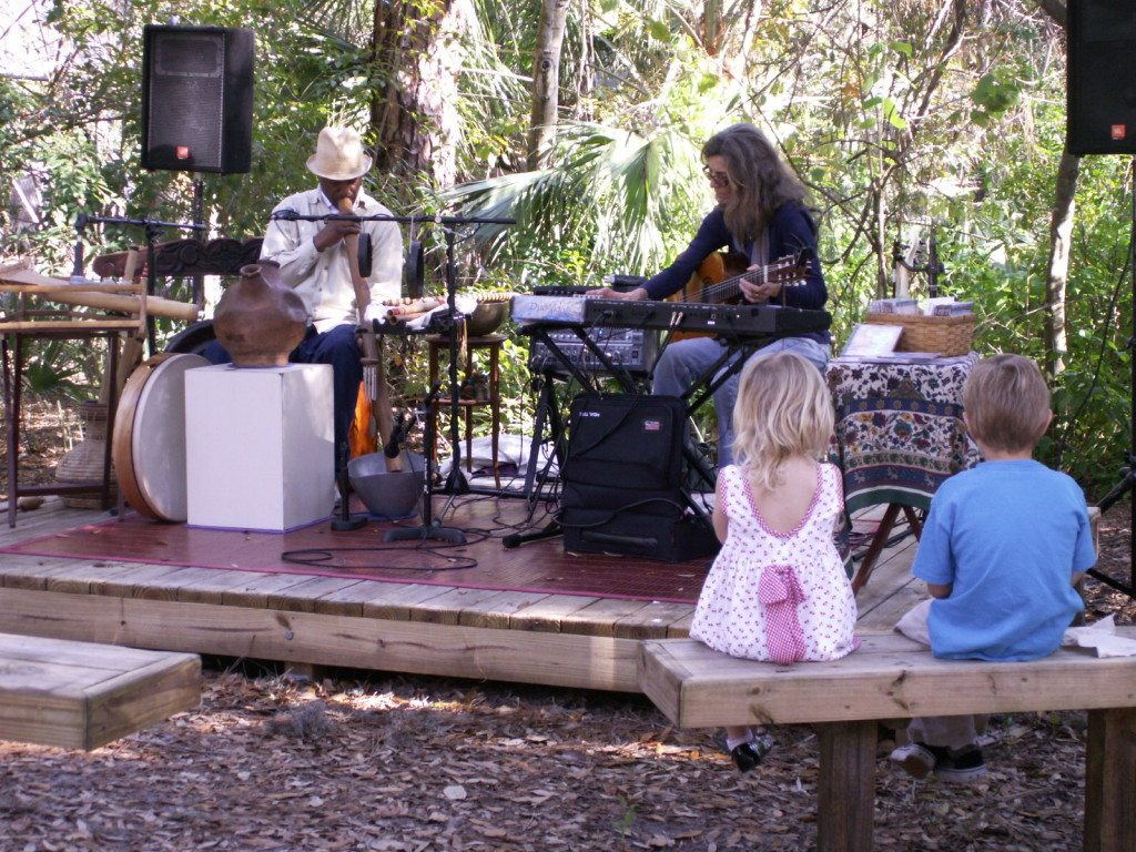 Children listen to music by Duo Vida of St. Petersburg at Saturday's Raptor Fest.
