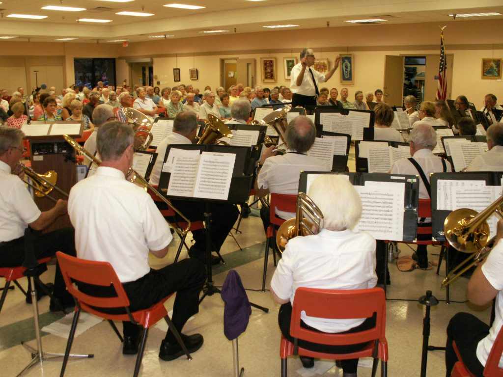 John Hoover, music director and conductor of the South Pasadena Community Band, directs the musicians during a performance April 15 at the Treasure Island Community Center attended by about 100 people.