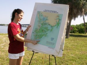 Tampa Bay Watch communications coordinator Rachel Arndt points out areas where scallops will be counted  Saturday, August 22 during the annual Great Bay Scallop Search.