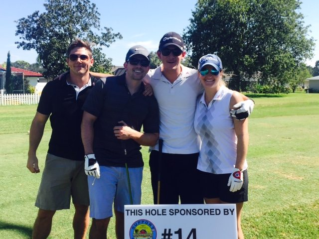 Golf tournament participants, from left, Brant Barlett, Sean Louderback, Robbie Williams, and Kerri Campbell