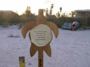 "A plaque names the organization that has ""adopted"" the nest with a $35 donation to the non-profit Sea Turtle Trackers."